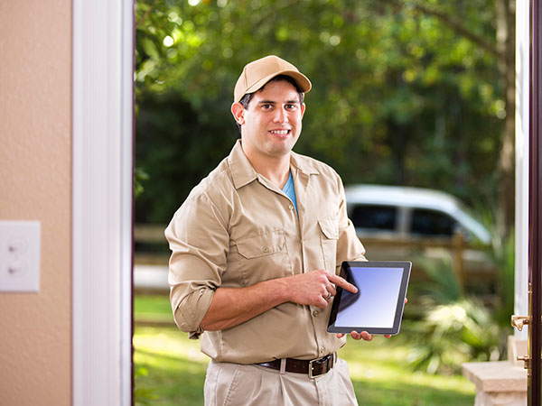 Scam Alert - Man at the door with tablet looking like an official employee.