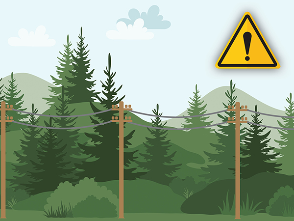 Trees and hills in the background with Power Lines in front. There is a yellow caution sign with an exclamation symbol in the upper right-hand corner of the photo.